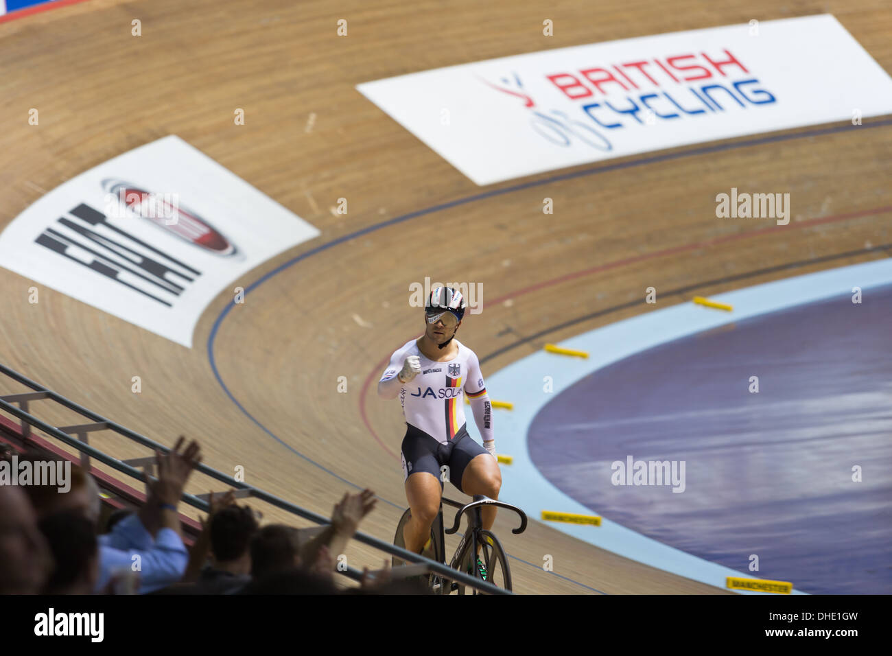 Robert Forstemann acknowledges his win at the UCI Track Cycling World Cup Manchester 2013. - Stock Image