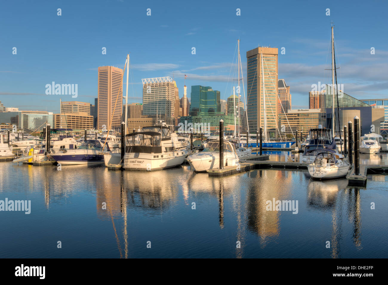 Baltimore skyline, including the Transamerica Tower and World Trade Center, reflected in the waters of the Inner Harbor. - Stock Image