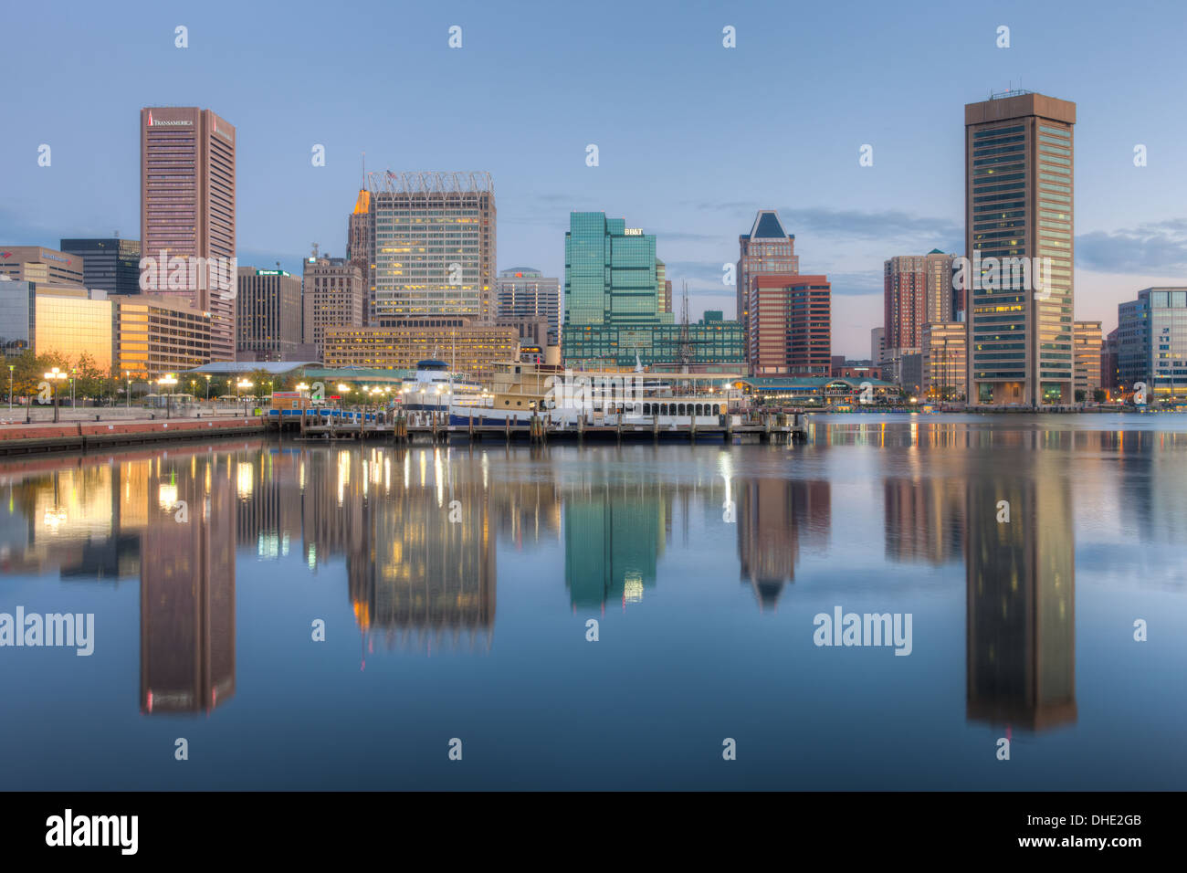 Baltimore skyline at dawn, including the Transamerica Tower and World Trade Center, reflected in the waters of the Stock Photo