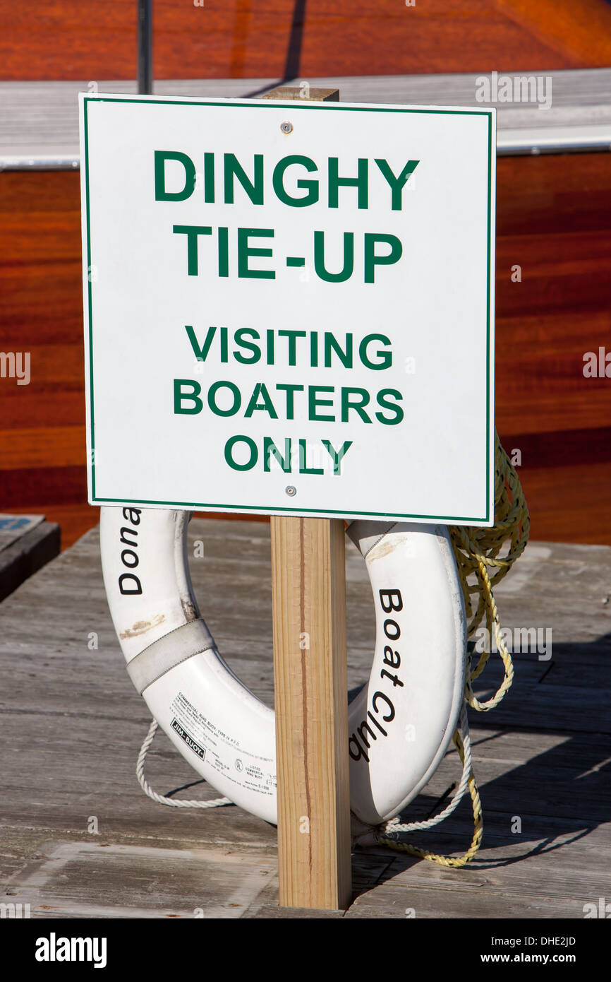 A sign indicates a location for dinghy tie-ups for visiting boaters at the public landing in Belfast, Maine. - Stock Image