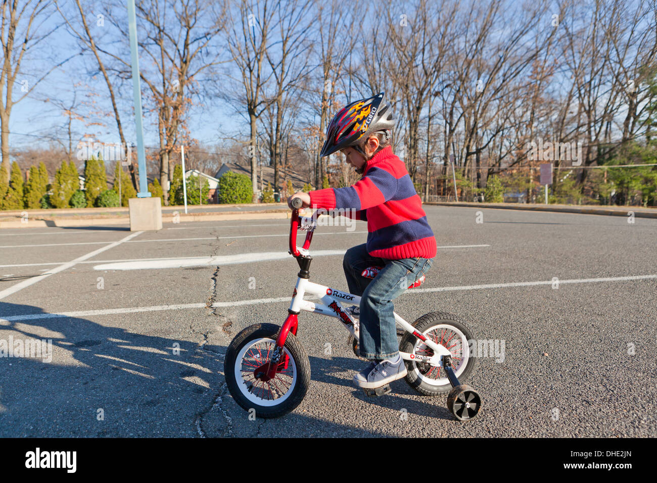 0ec08c62f5d Asian boy 3 years old, riding bicycle with training wheels - Stock Image