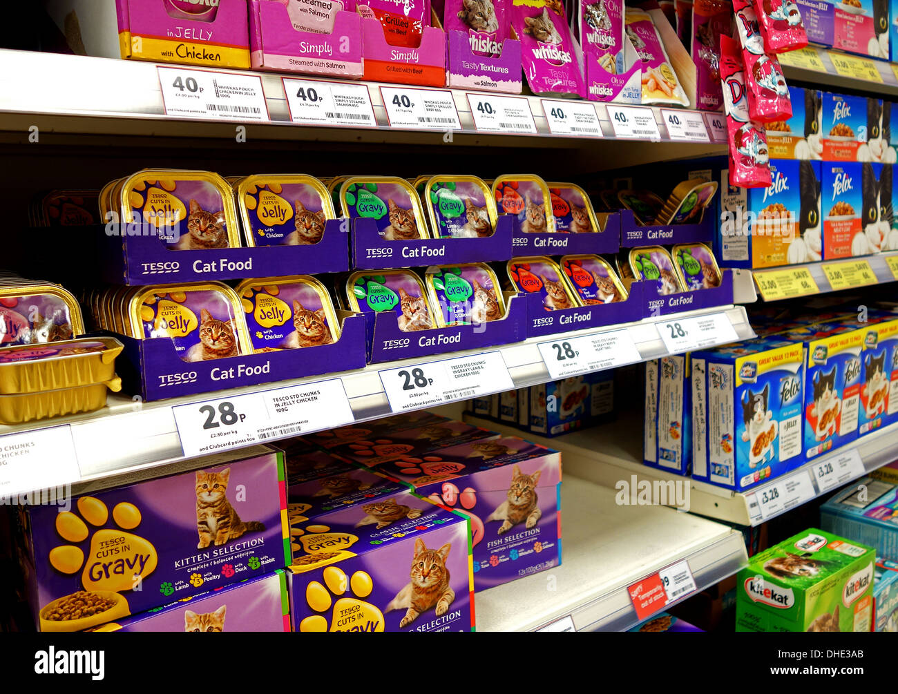 tins and boxes of cat food in a supermarket - Stock Image