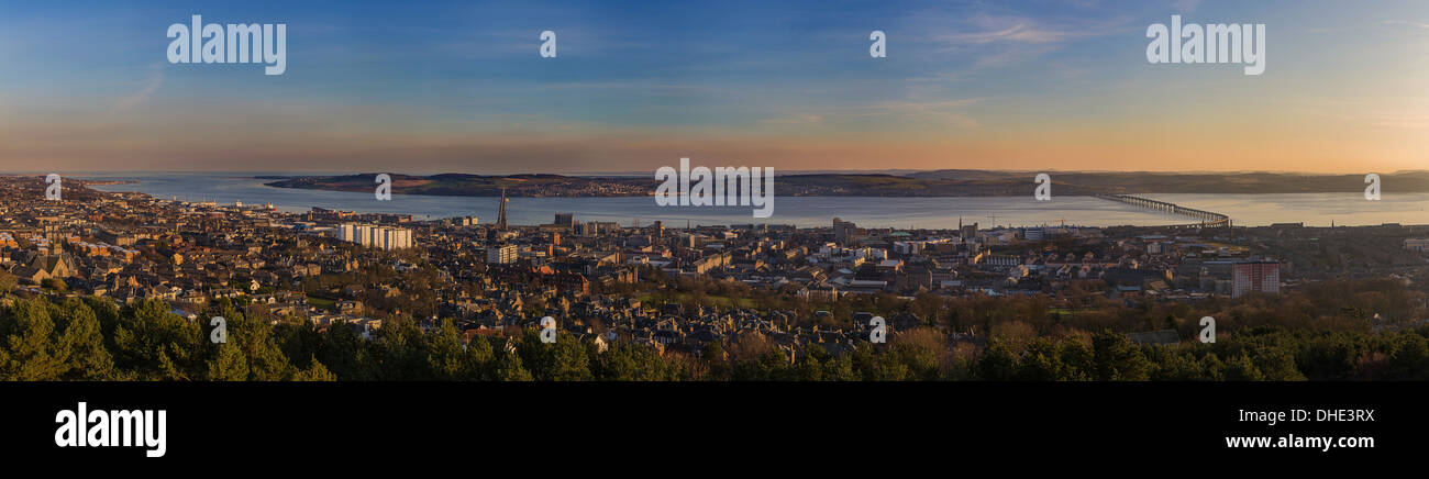Panoramic photo from the Law Hill, Dundee, Scotland of the City of Dundee, the River Tay and looking towards Fife at sunset - Stock Image