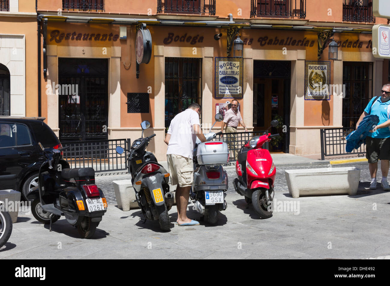 Scooters parked on Carretera Espinel in Ronda, Spain - Stock Image