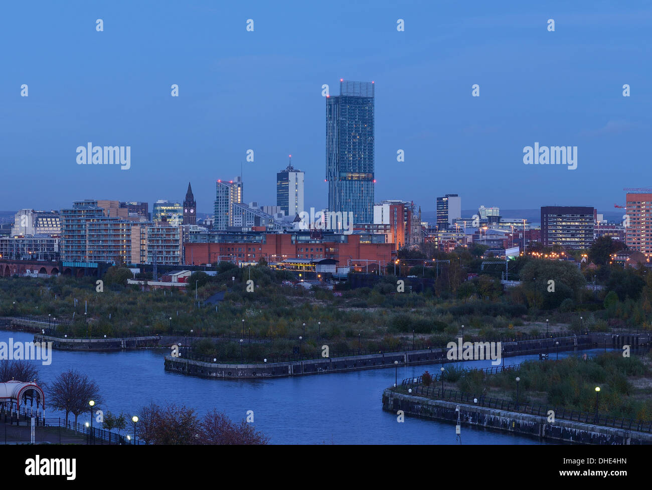 Manchester city centre skyline at dusk including the Town Hall and Beetham Tower - Stock Image