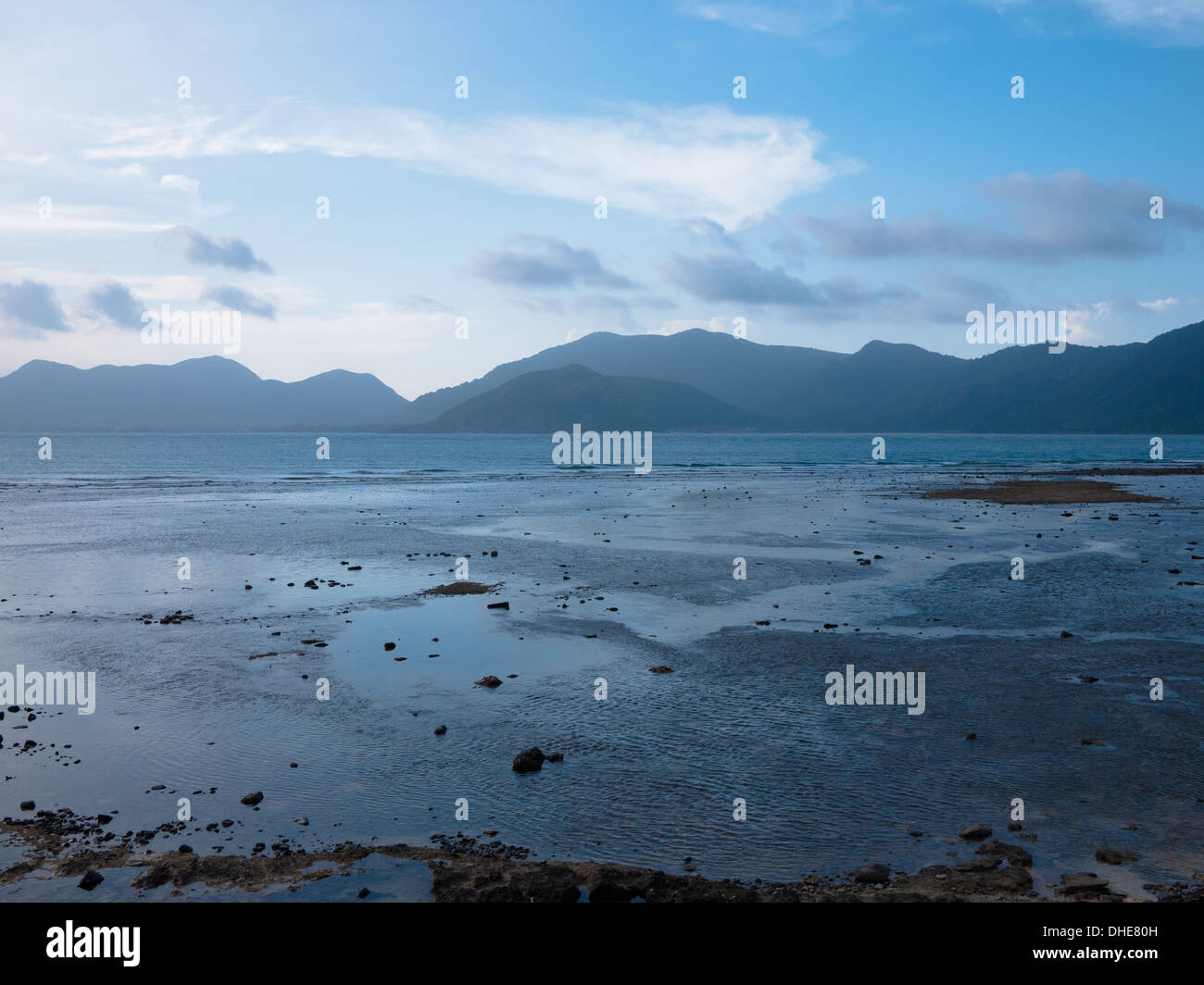 A view of Con Son Island and the South China Sea as seen from Bay Canh Island, one of the Con Dao Islands, Vietnam. - Stock Image