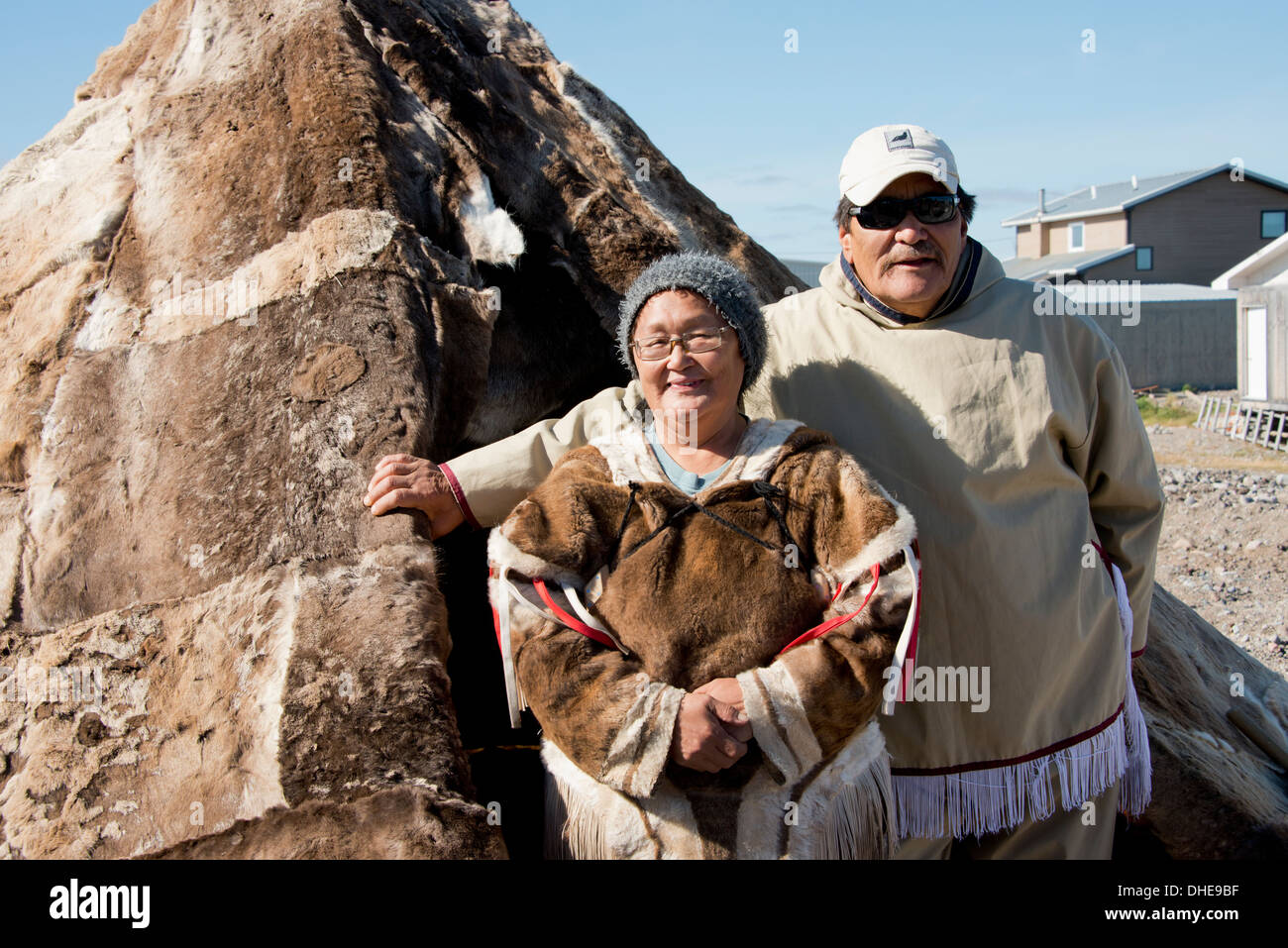 Canada, Nunavut, western shore of Hudson Bay, Kivalliq Region, Arviat. Inuit couple (Mary & Peter) in traditional arctic attire. - Stock Image