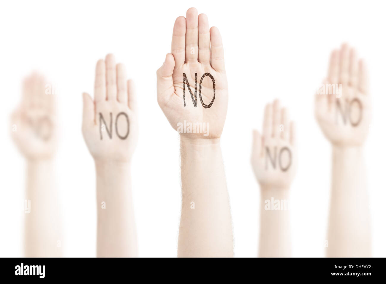 Hands raised to the sky on a white background, expression of protest. On the palms there is an inscription — 'No'. - Stock Image