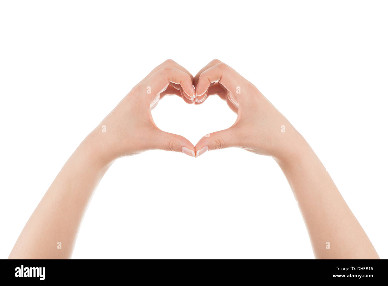 Two woman's hands are forming heart shape on white background. - Stock Image