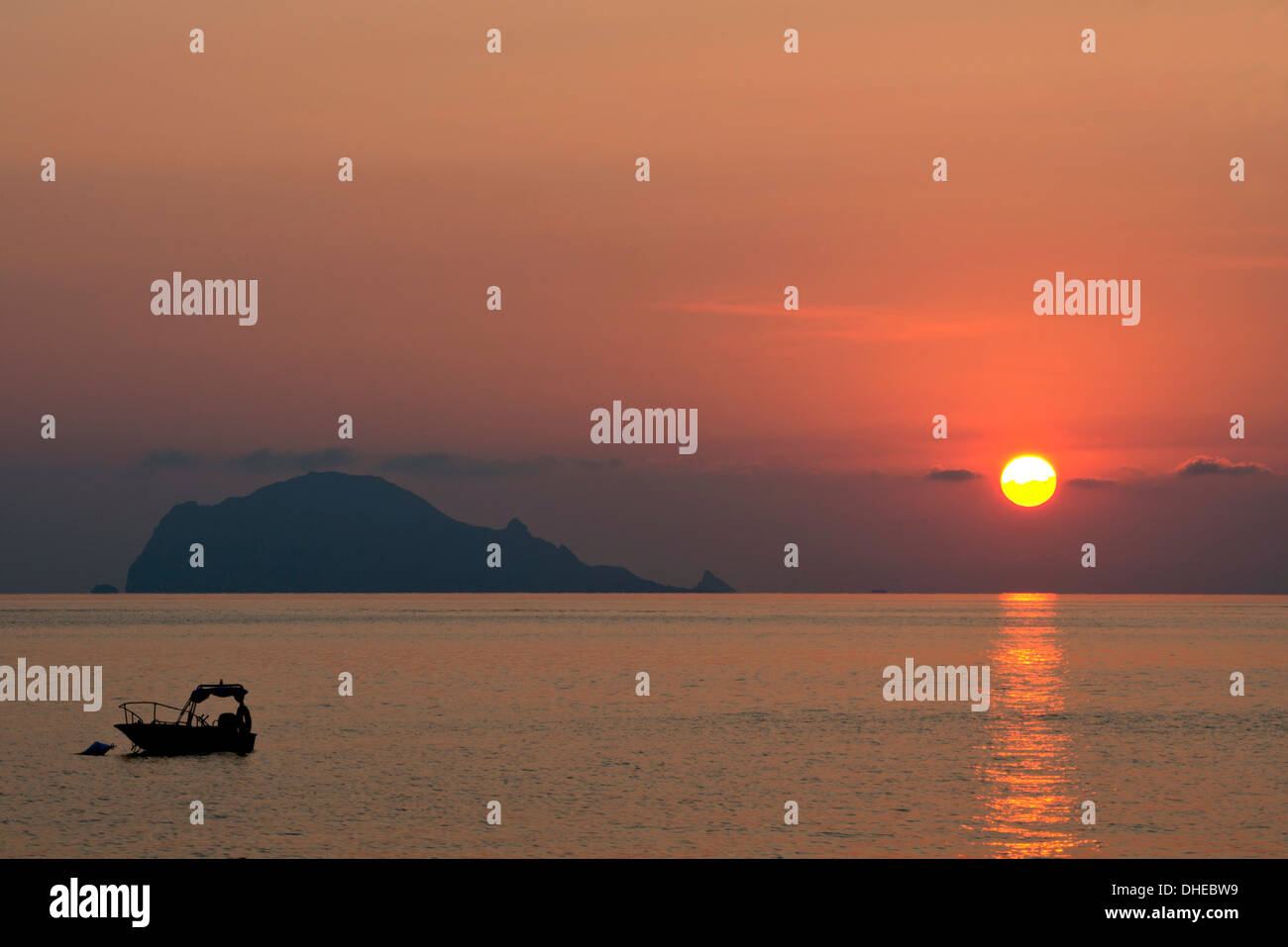 A view to Filicudi Island from Salina Island at sunrise in The Aeolian Islands, UNESCO, off Sicily, Messina Province, Stock Photo