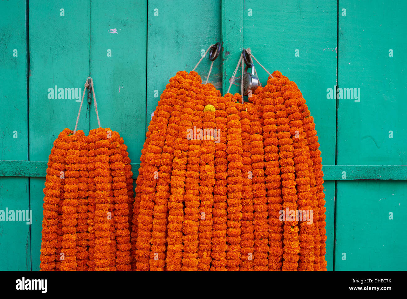 Door, padlock and flower garlands, Kolkata (Calcutta), West Bengal, India, Asia - Stock Image