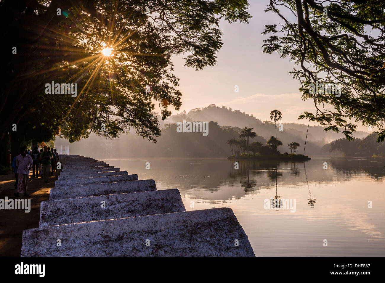 Sunrise at Kandy Lake and the island which houses the Royal Summer House, Kandy, UNESCO, Central Province, Sri Lanka - Stock Image