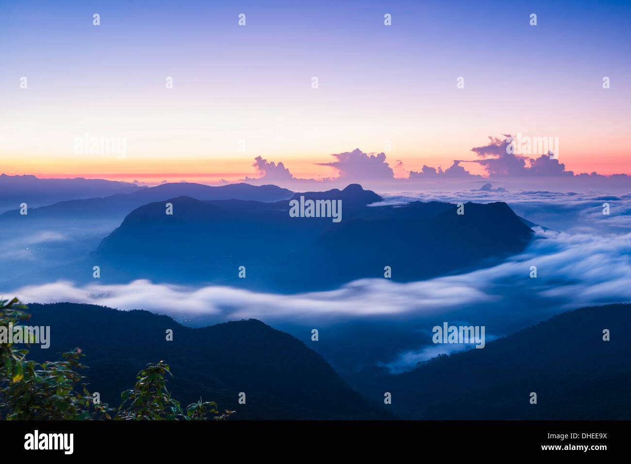 View of mountains from the 2443m summit of Adams Peak (Sri Pada) at sunrise, Central Highlands, Sri Lanka, Asia - Stock Image