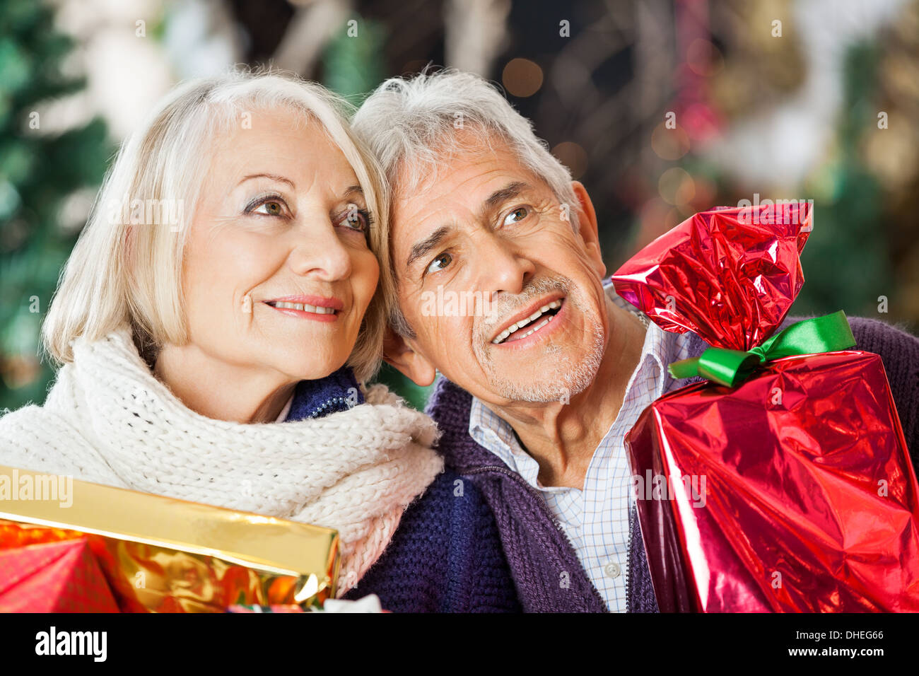 Couple With Christmas Presents In Store - Stock Image