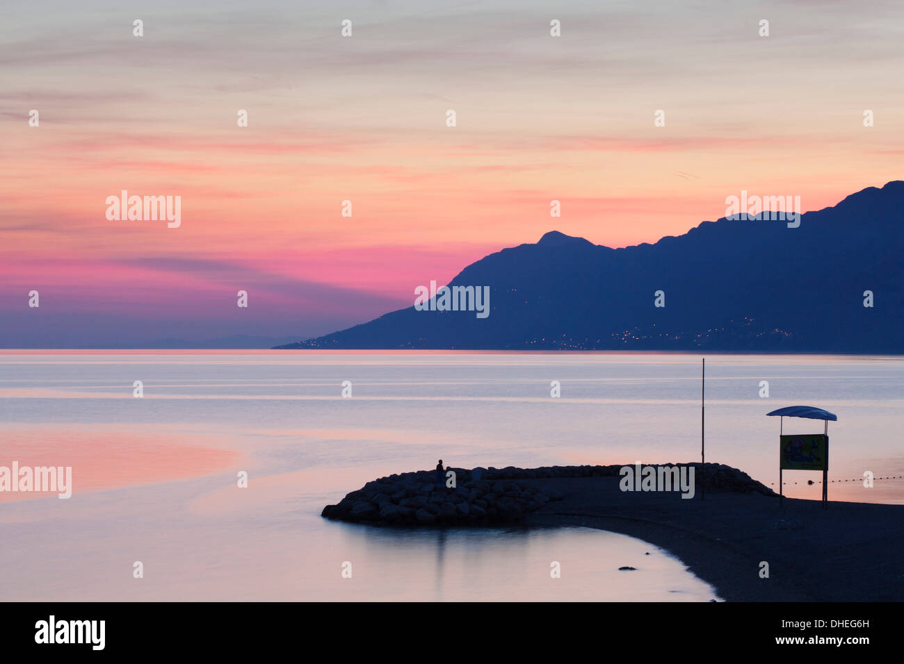 Sunset at the beach of Baska Voda, Makarska Riviera, Dalmatia, Croatia, Europe - Stock Image