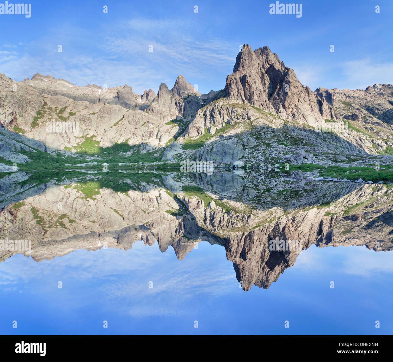 Pic Lombarduccio reflecting in Lac de Melo, Gorges de la Restonica, Haute Corse, Corsica, France, Europe - Stock Image