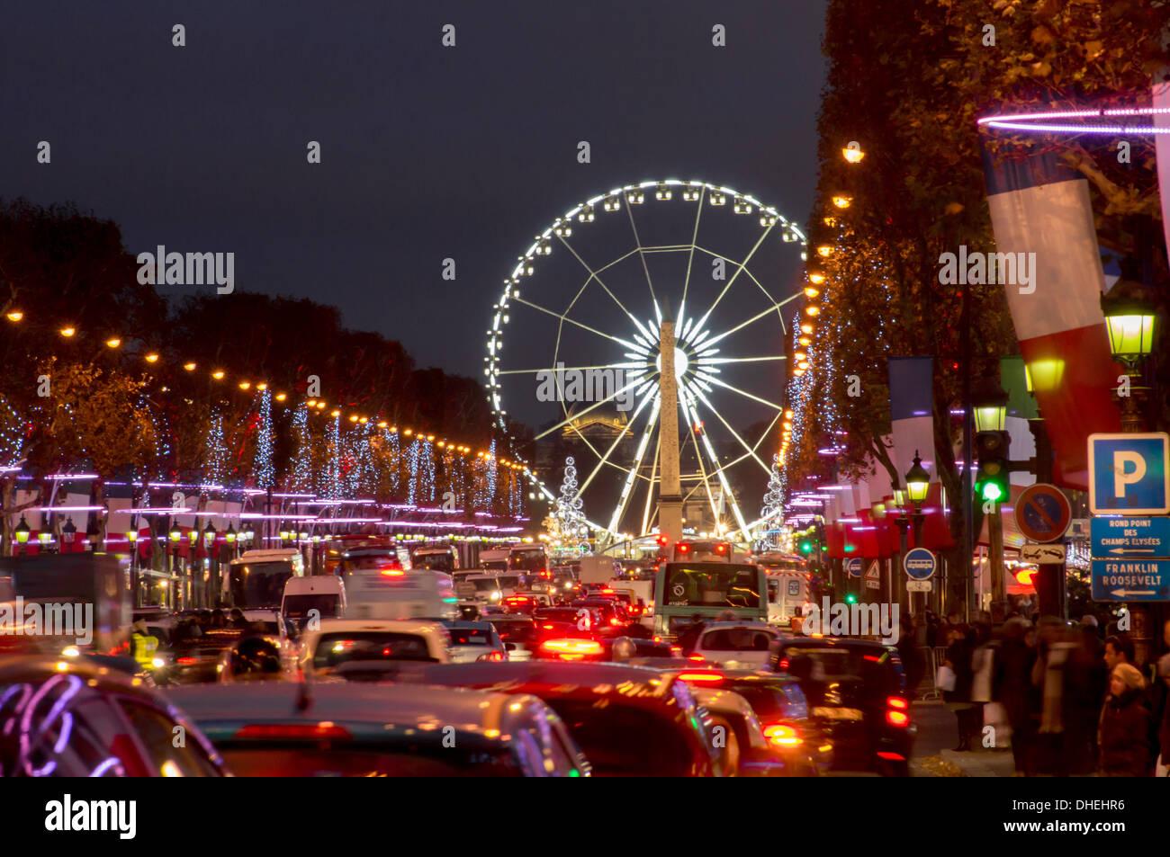 Roue de Paris and Champs Elysees at dusk, Paris, France, Europe - Stock Image