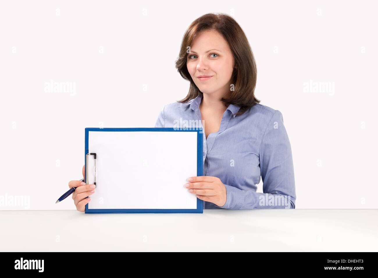 Business woman is holding a blank clipboard, business concept - Stock Image