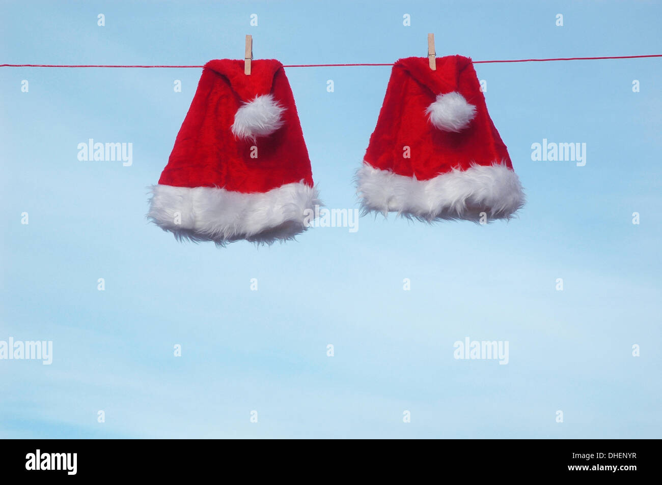 Illustration - Two Santa Claus hats are pictured on a clothesline, 28 December 2009. Photo: Berliner Verlag/Steinach Stock Photo
