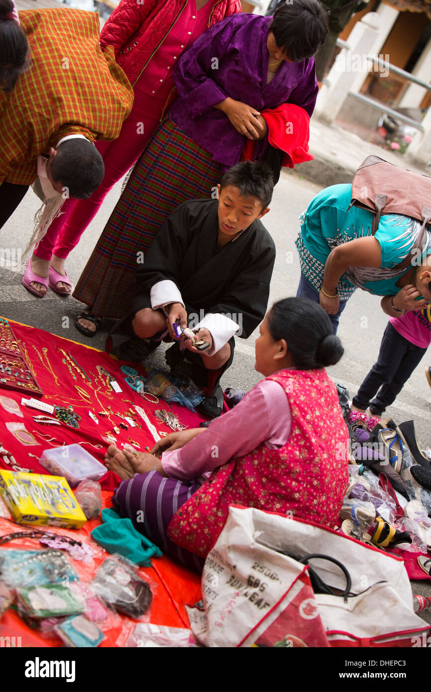 Bhutan, Thimpu, Norzim Lam, traditionally dressed people at Tsechu market stall - Stock Image