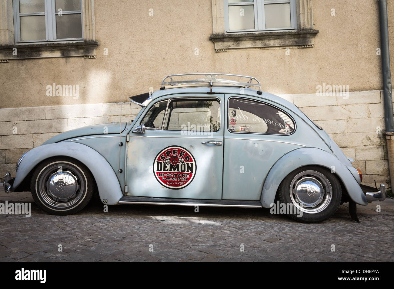 Old classic VW Beetle parked in street, Grignan, France. - Stock Image