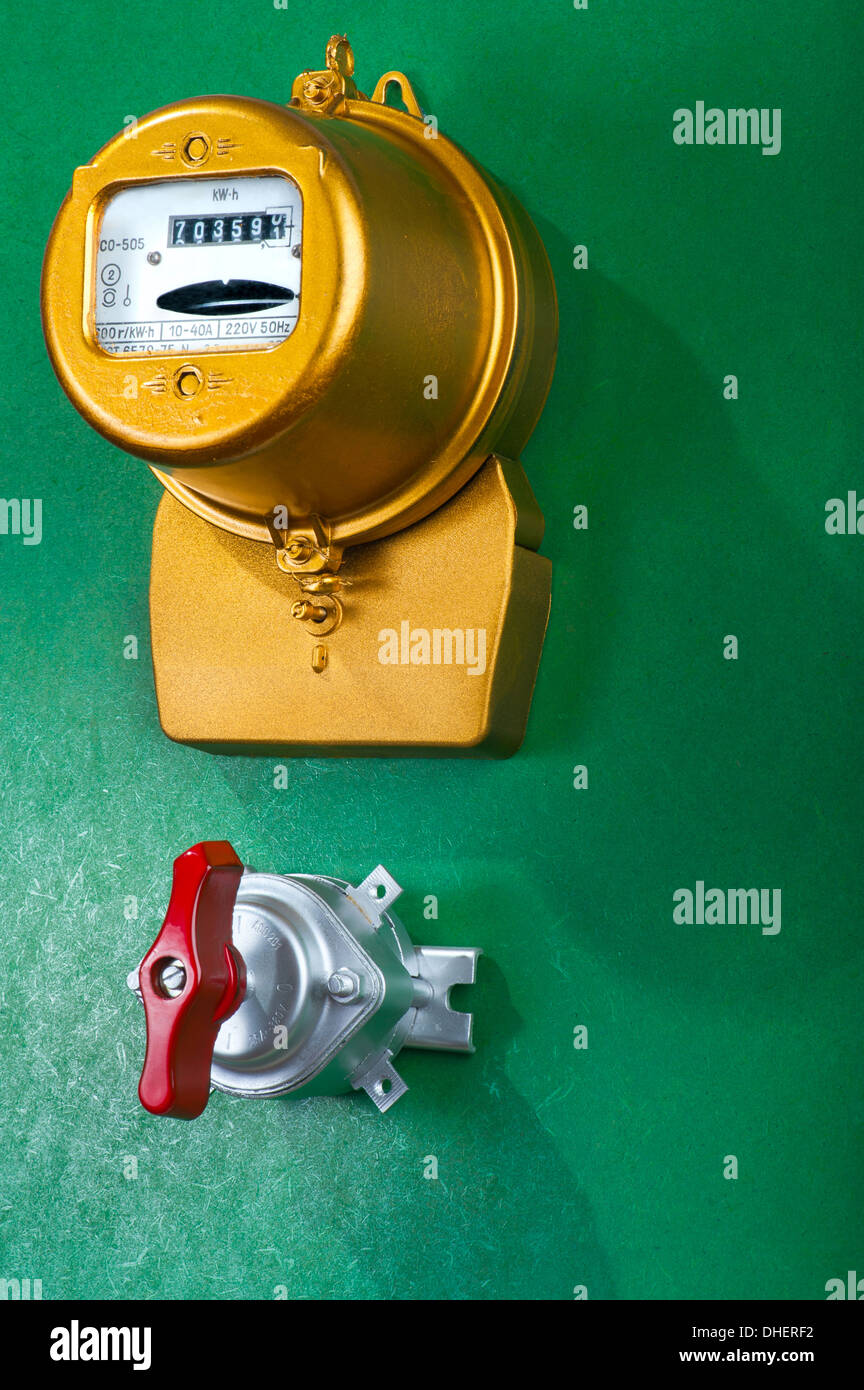 Golden retro electric meter with toggle switch - Stock Image