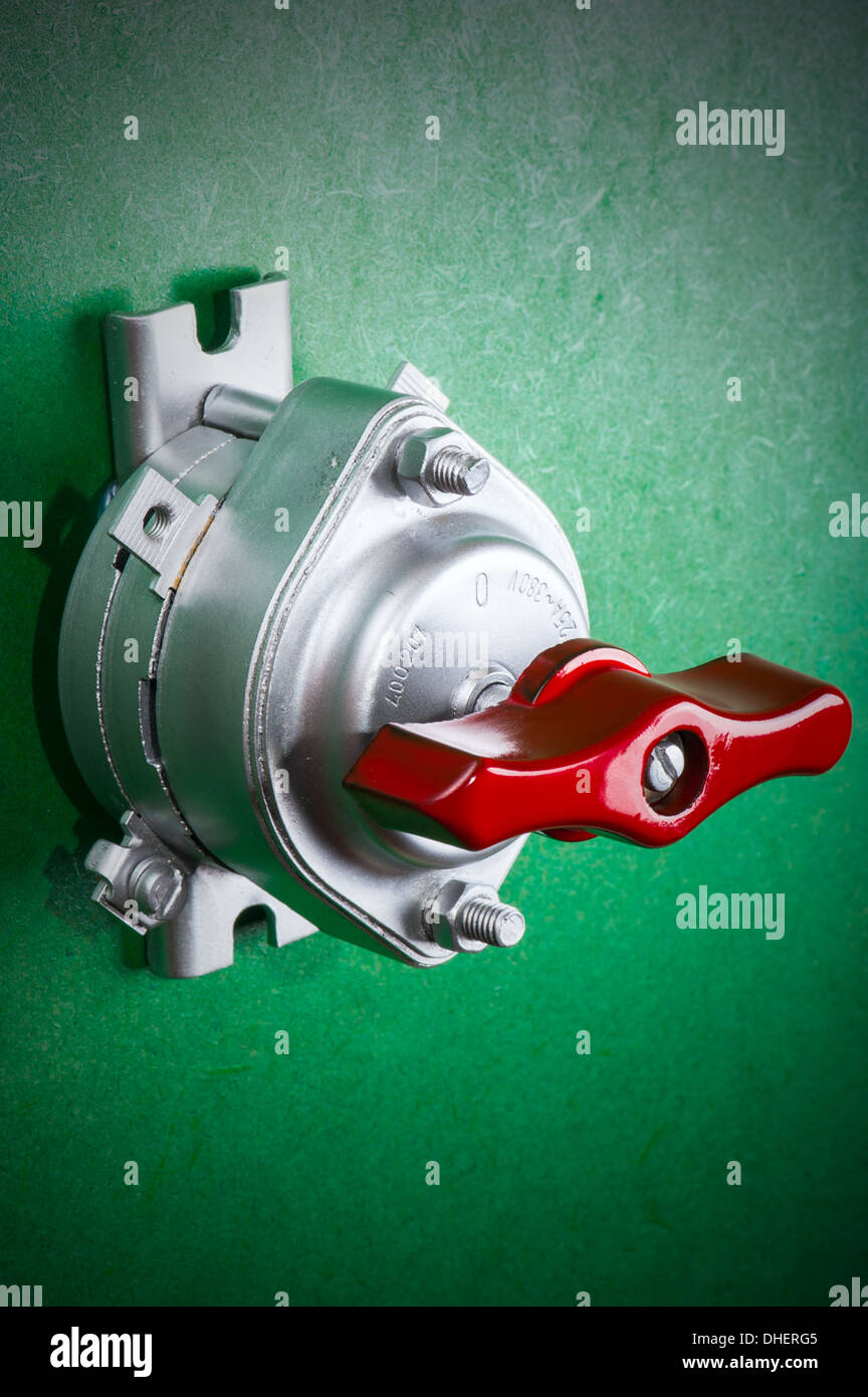tool on green - chrome retro toggle switch - Stock Image