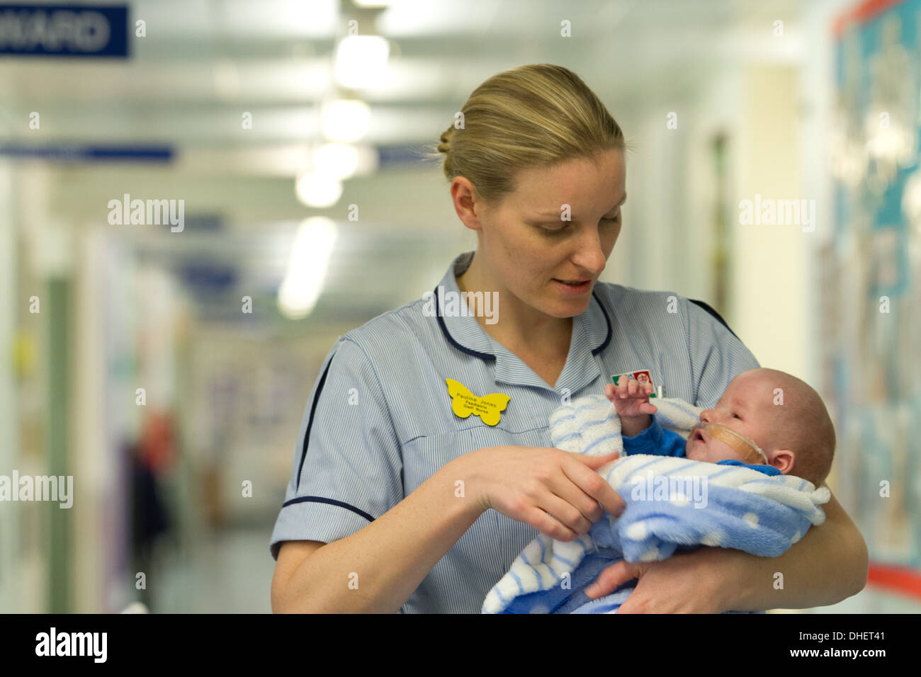 A pediatric nurse with a baby UK - Stock Image