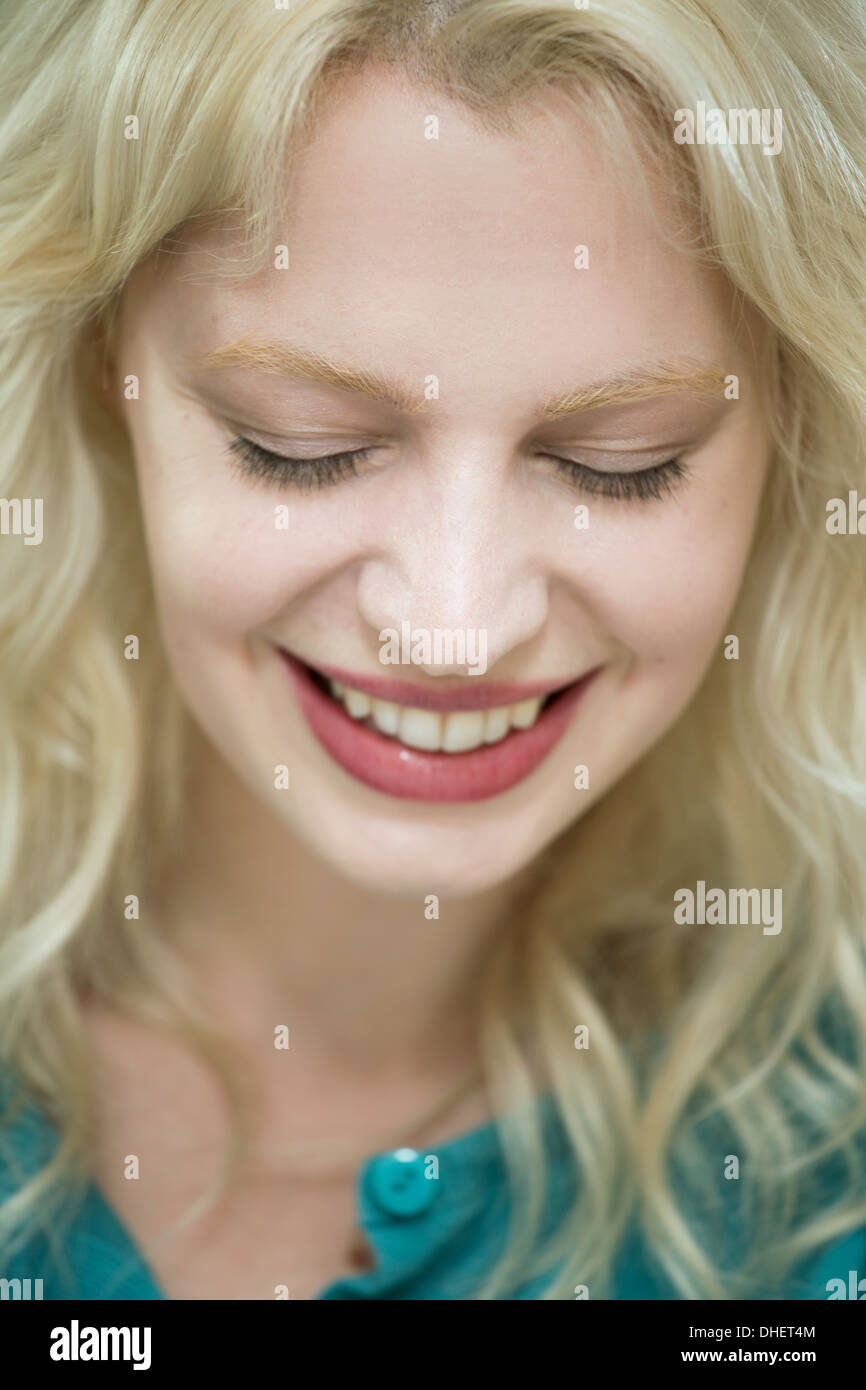 Young woman with eyes closed - Stock Image