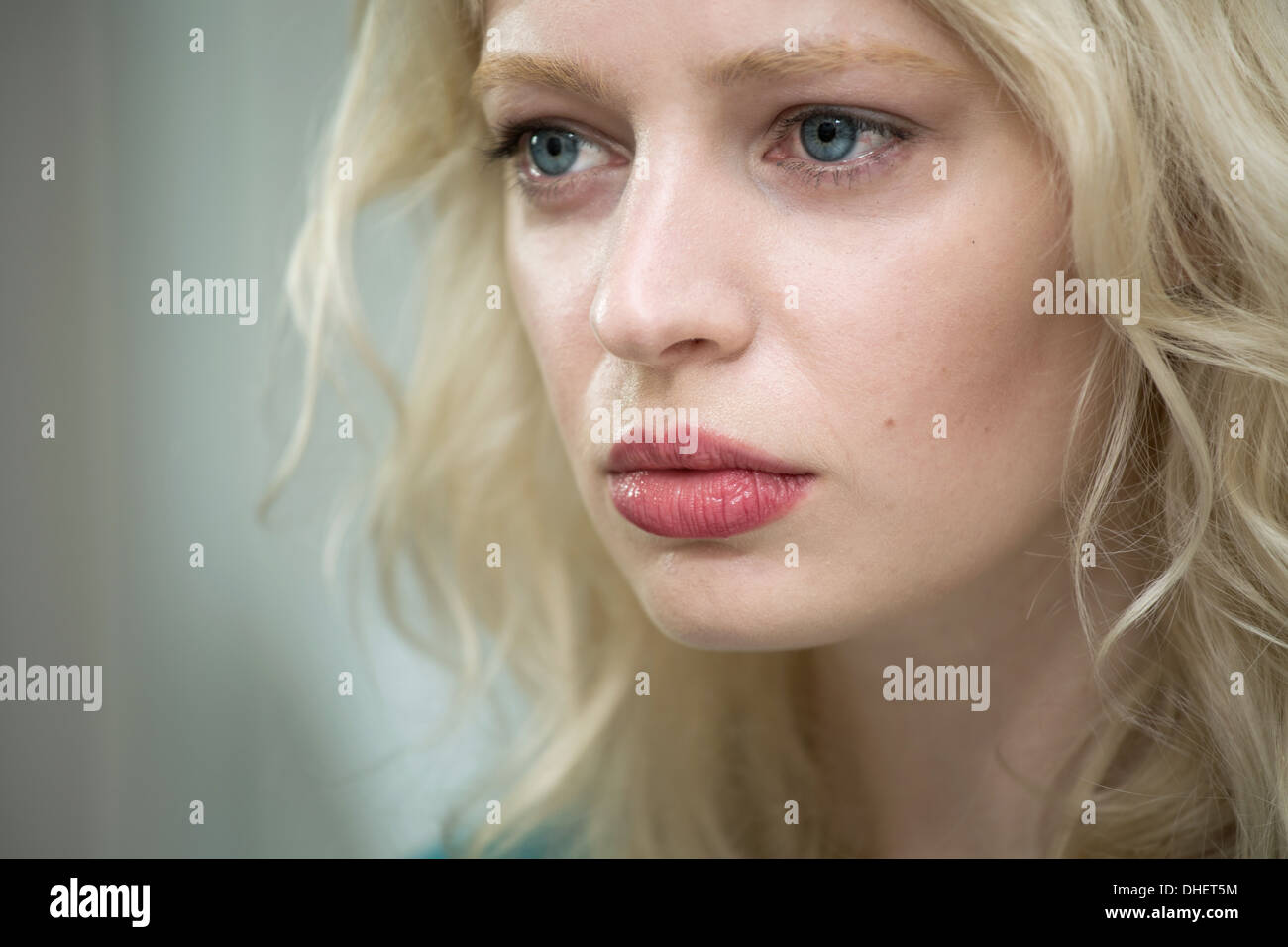 Young woman looking sad - Stock Image