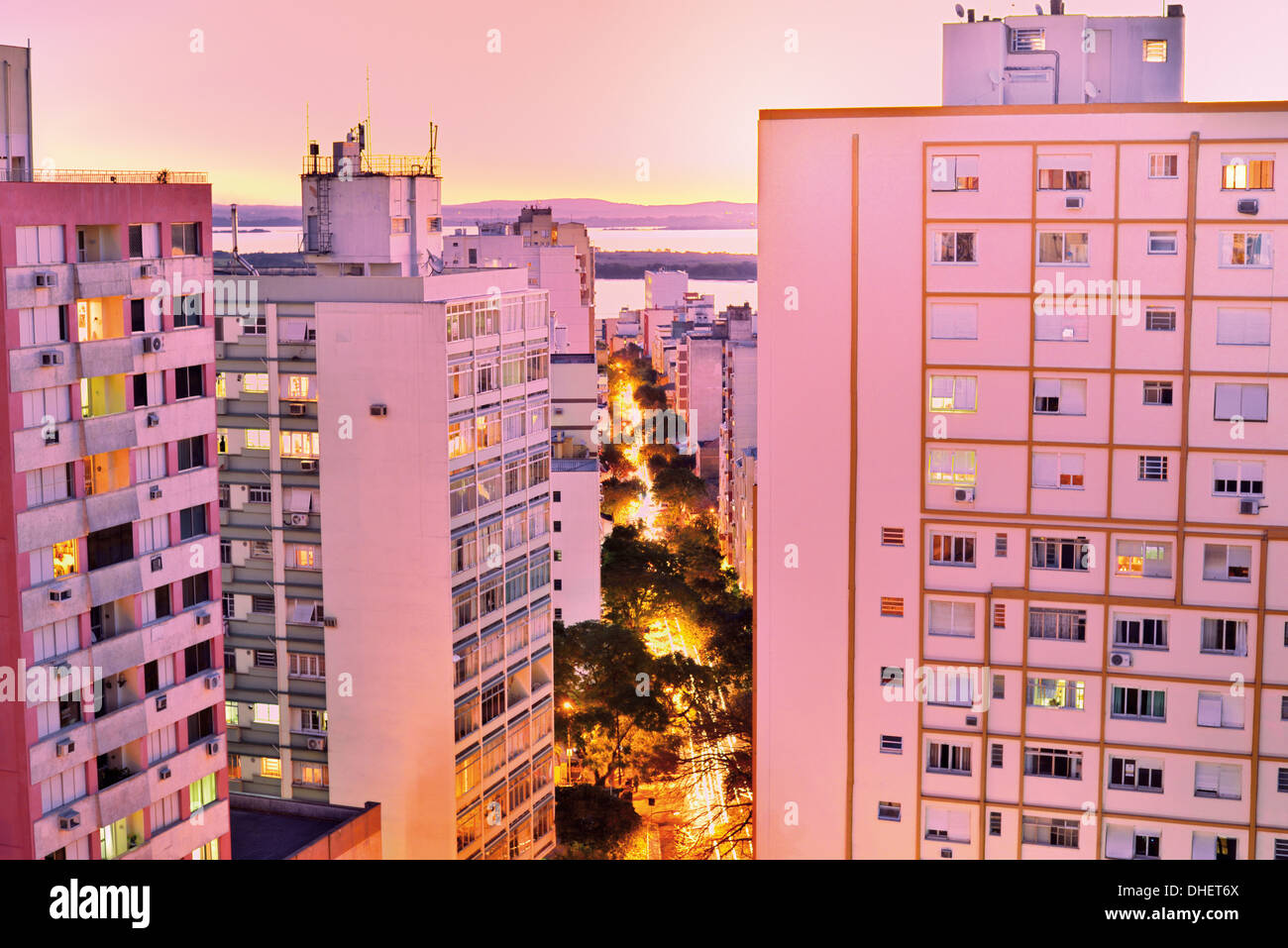 Brazil, Rio Grande do Sul: Nocturnal top view to Porto Alegres high rise towers and illuminated buildings - Stock Image
