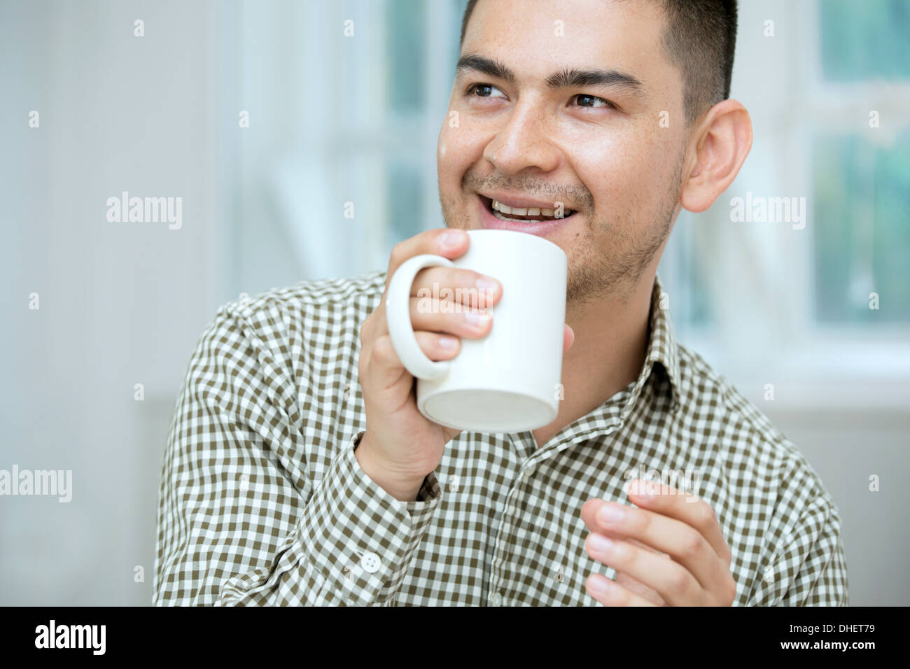 Mid adult man having coffee - Stock Image