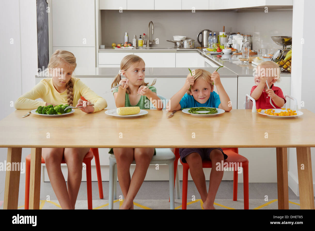Children refusing to eat vegetables - Stock Image