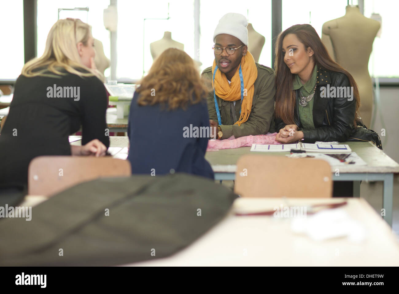 Fashion design students in class - Stock Image