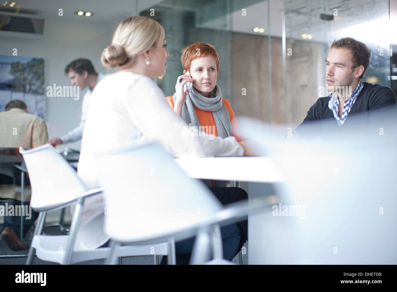 Businesspeople having meeting at conference table - Stock Image