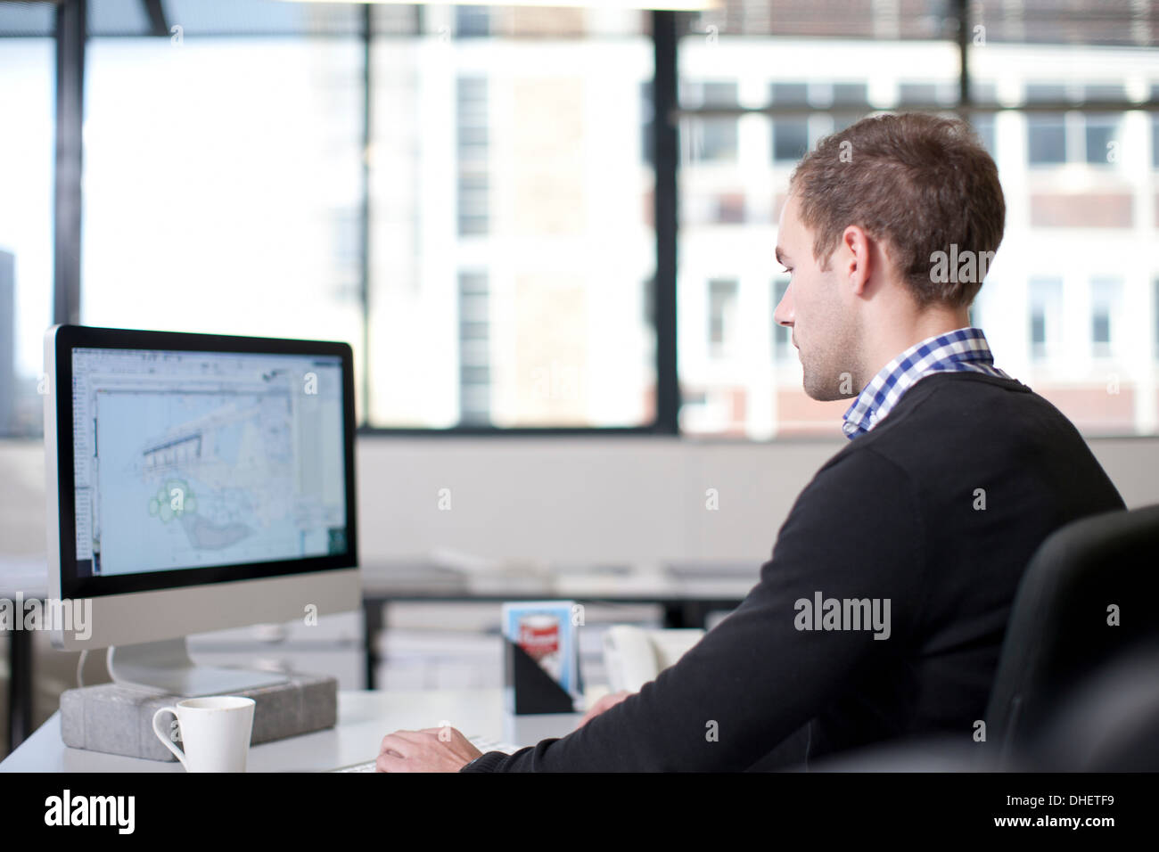 Man using computer in office - Stock Image