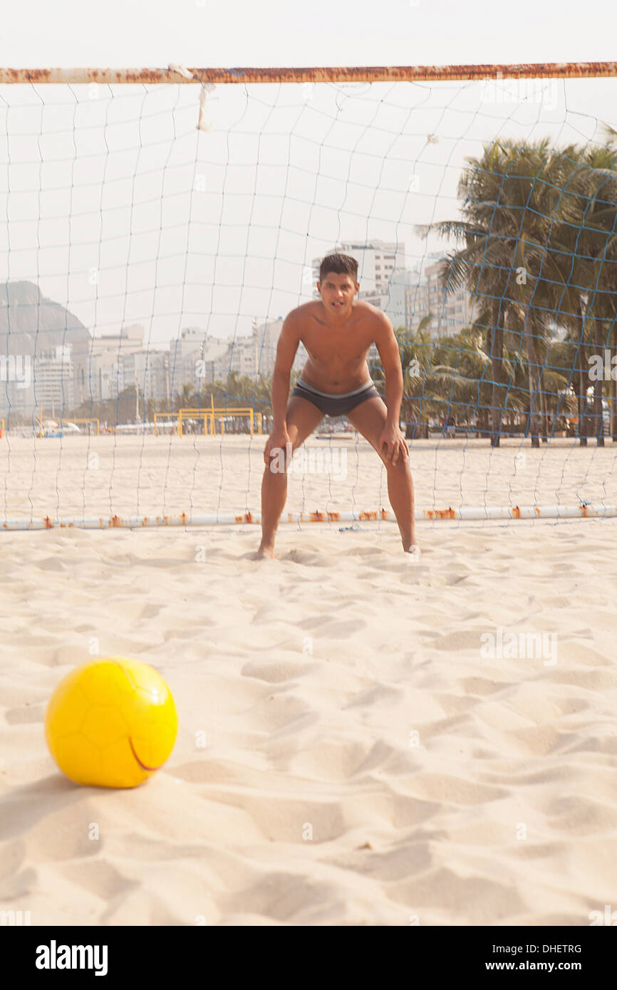 Goalkeeper in defence postion on beach - Stock Image