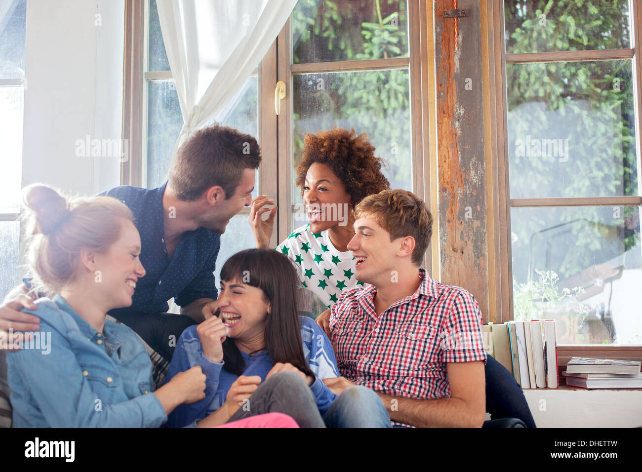 Group of friends laughing - Stock Image