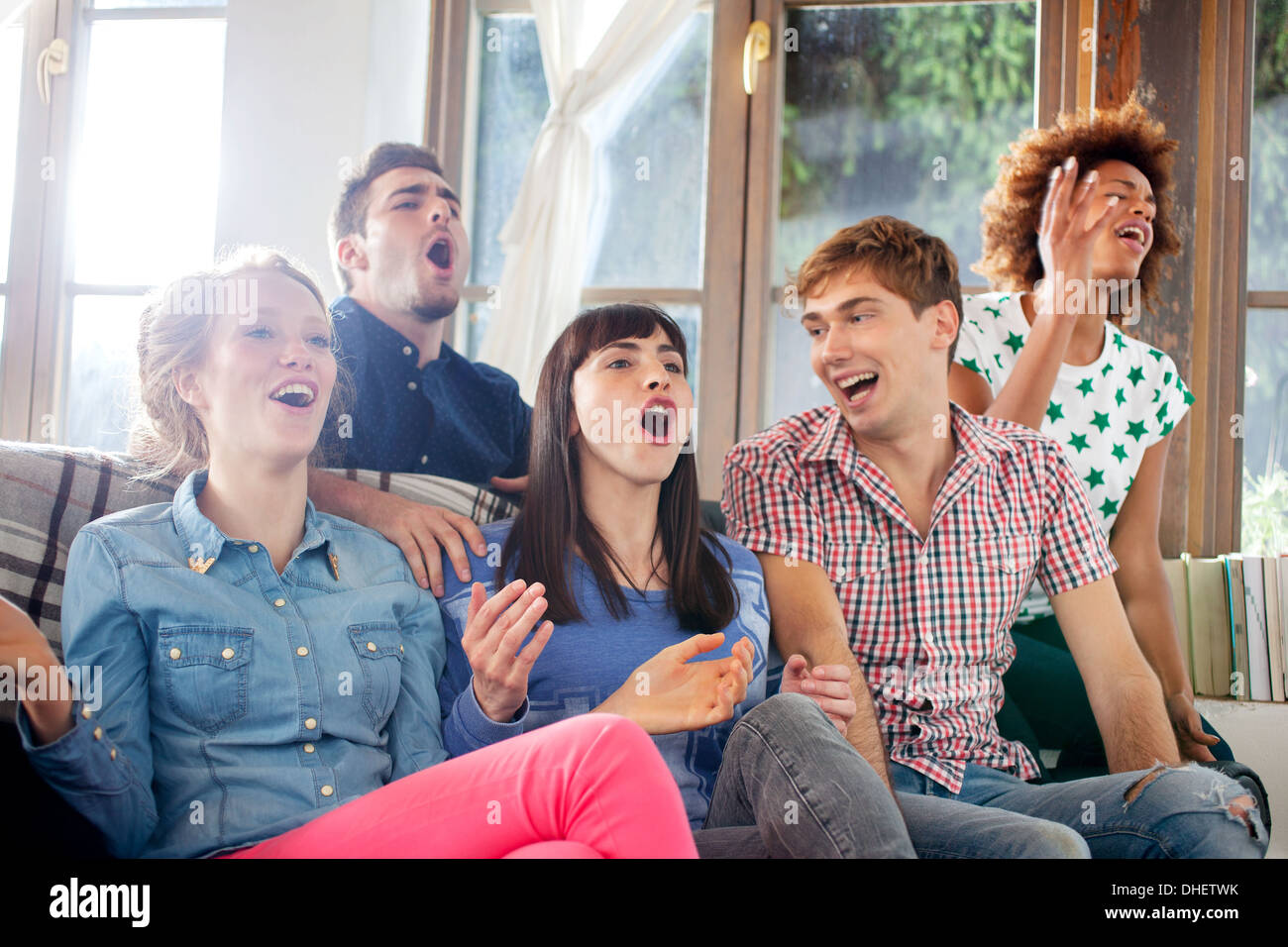Five friends watching television - Stock Image