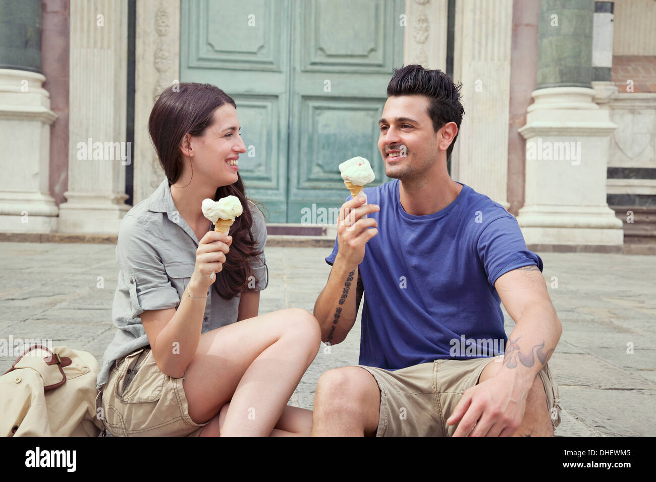 Couple eating ice creams, Santa Maria Novella square, Florence, Tuscany, Italy - Stock Image