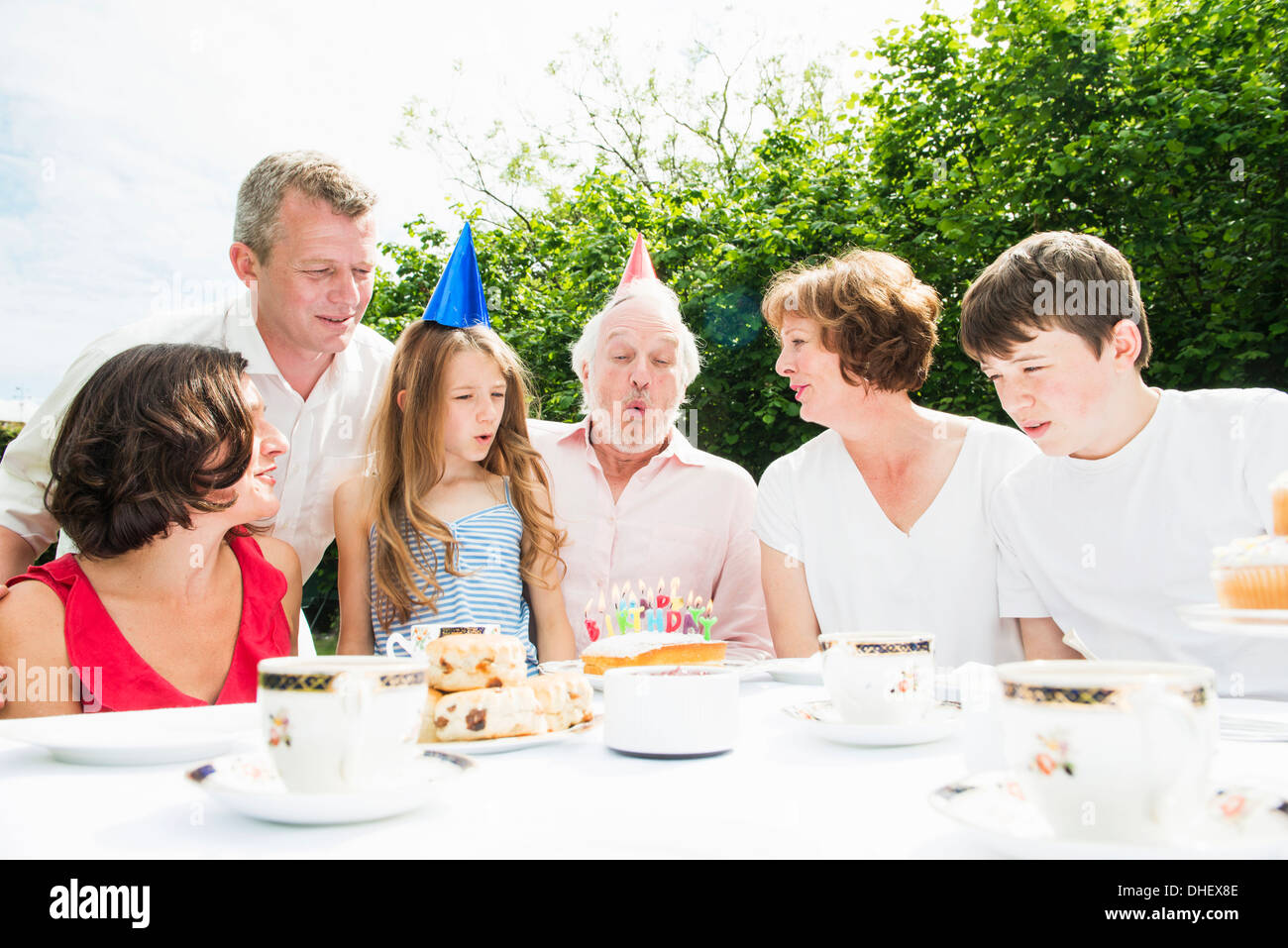 Family celebrating grandfather's birthday - Stock Image