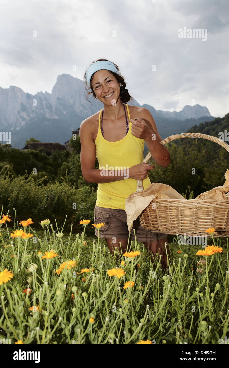 Woman with basket - Stock Image