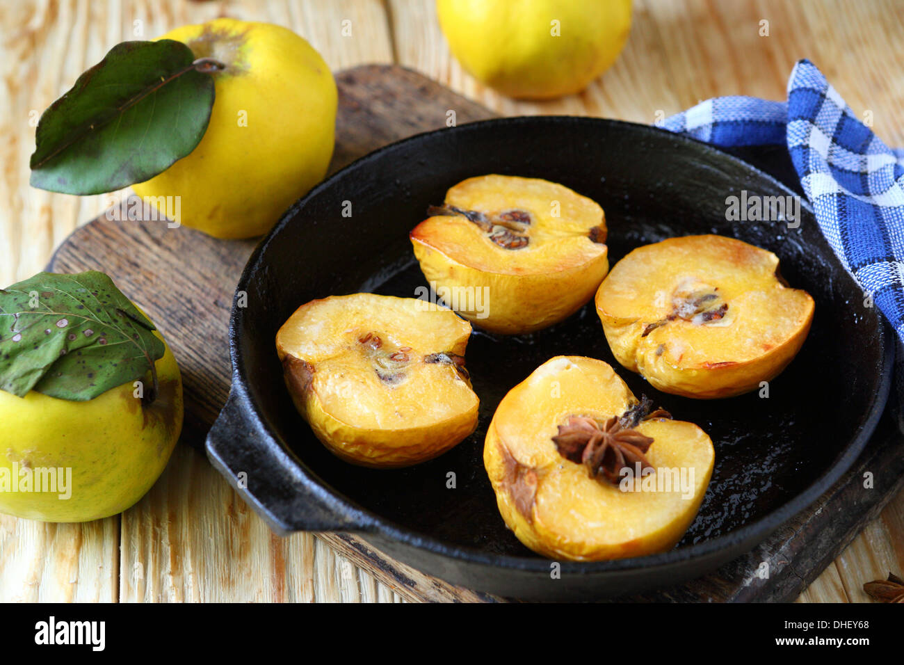 baked quince with honey in a pan, food - Stock Image