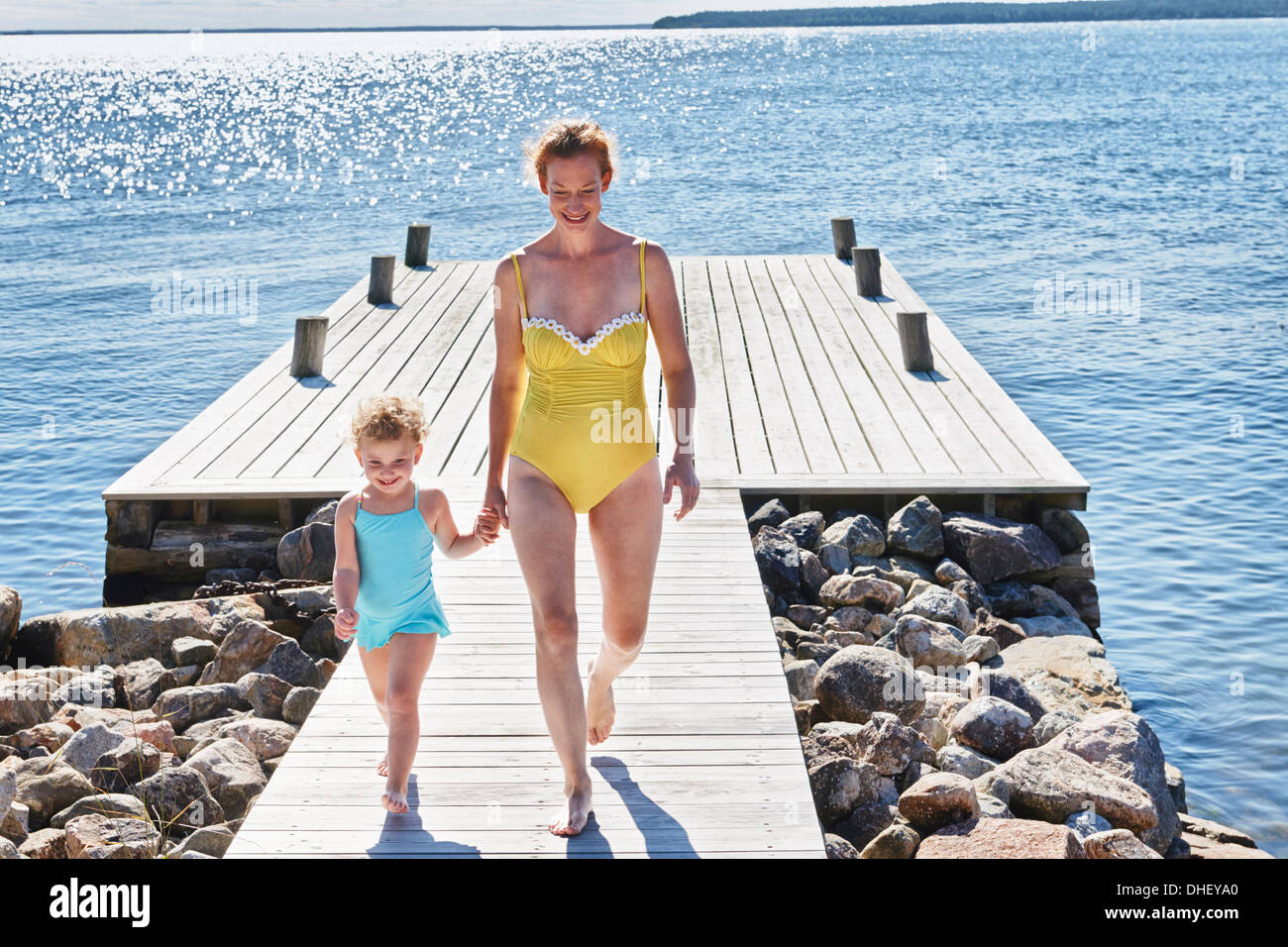 Mother and daughter hand in hand, Utvalnas, Gavle, Sweden - Stock Image