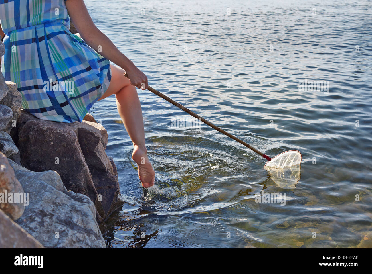 Close up of woman with fishing net, Utvalnas, Gavle, Sweden - Stock Image