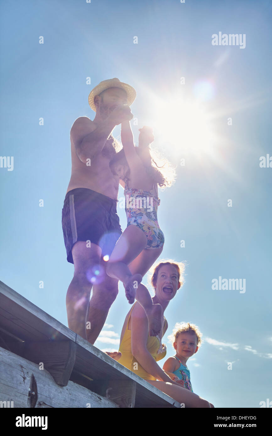 Young family playing on pier, Utvalnas, Gavle, Sweden - Stock Image