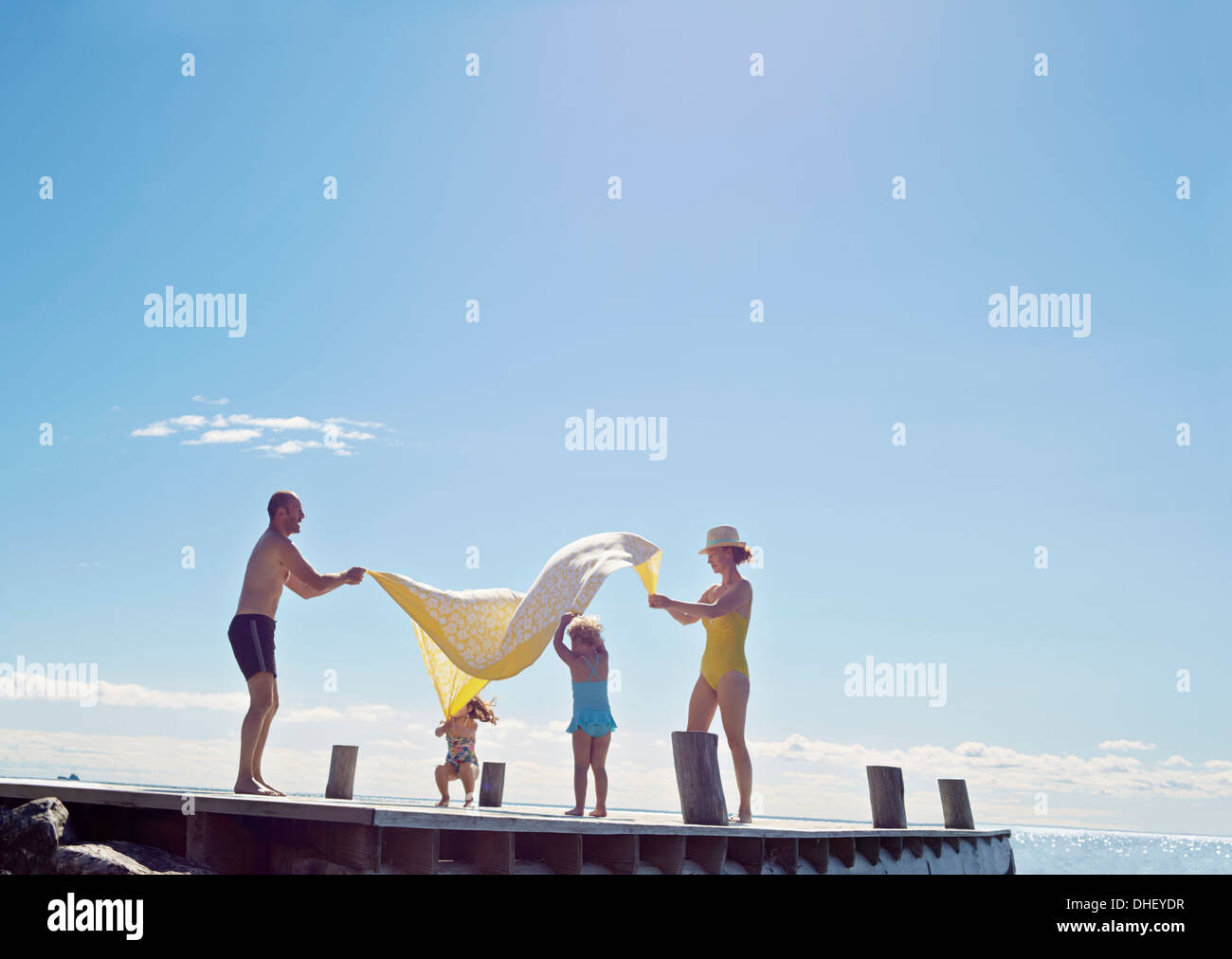 Young family having fun on pier, Utvalnas, Gavle, Sweden - Stock Image