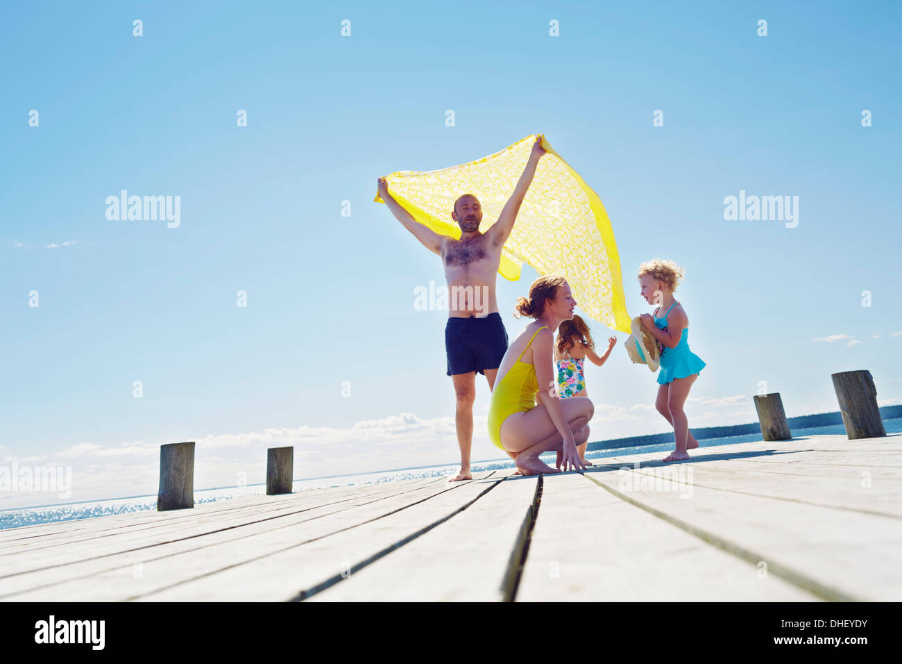 Young family on pier, Utvalnas, Gavle, Sweden - Stock Image