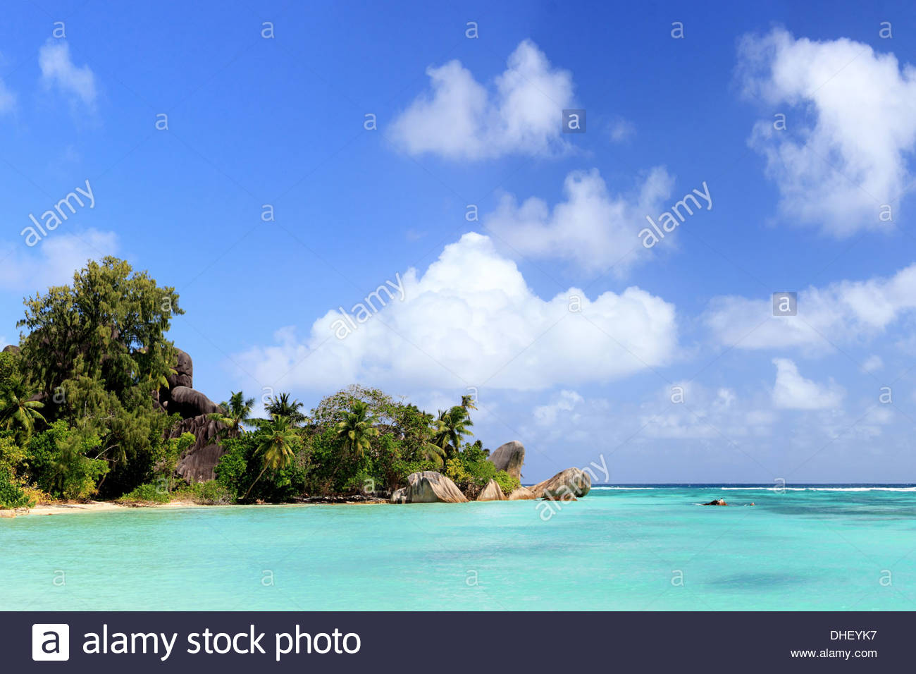 Turquoise sea and trees, La Digue, Seychelles - Stock Image