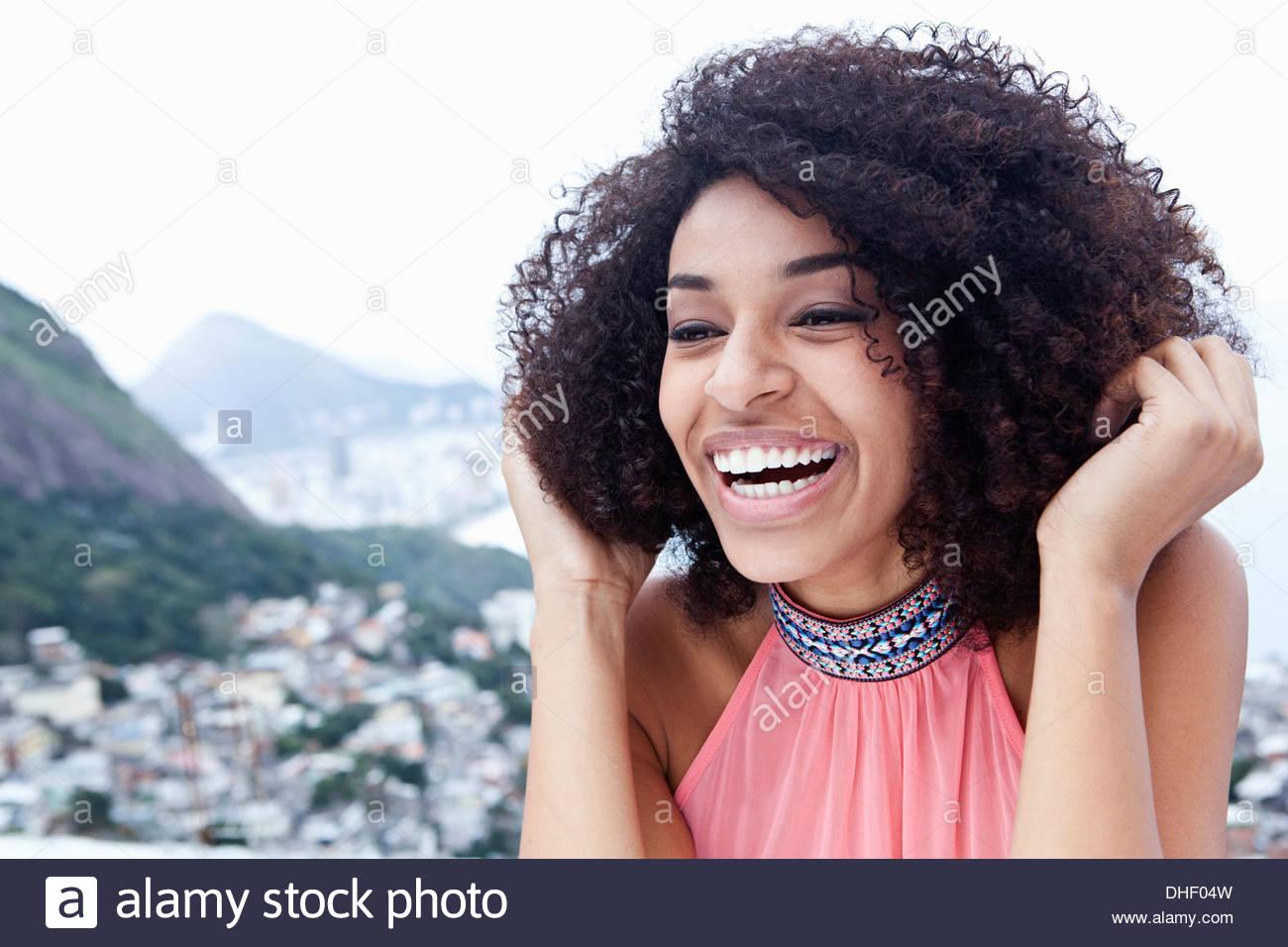 Close up portrait of happy young woman, Casa Alto Vidigal, Rio De Janeiro, Brazil - Stock Image